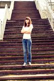 Beautiful girl standing at the old stairs. Toned image Royalty Free Stock Photography