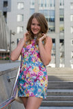 Beautiful girl standing on one streets of the city Royalty Free Stock Image