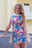 Beautiful girl standing on one streets of the city Royalty Free Stock Photography
