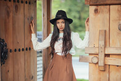 Beautiful girl standing and poses in vintage suit Royalty Free Stock Image