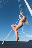 Beautiful girl standing on sailboat Royalty Free Stock Image