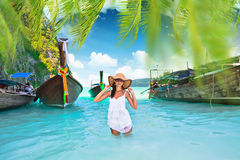 Beautiful girl standing in the sea in a landscape Royalty Free Stock Image