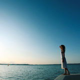 Beautiful girl standing on the shore Stock Photos