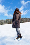Beautiful girl standing on snow Royalty Free Stock Images