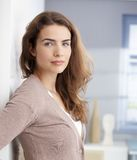 Beautiful girl standing at wall Royalty Free Stock Photos