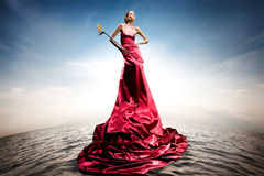 Beautiful girl standing on water Stock Image