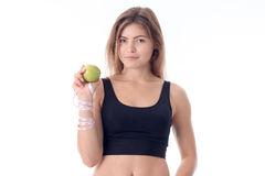 Beautiful girl stands directly and shows in one hand an apple Stock Images