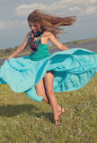 Beautiful girl stands on green field Royalty Free Stock Photos