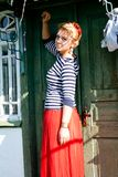 Beautiful girl stands near green grunge door Stock Photography