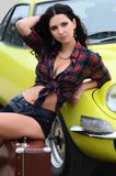 Beautiful girl stands near to car Stock Image