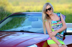 The beautiful girl stands near to white car Stock Photos