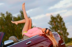 The beautiful girl stands near to white car Royalty Free Stock Images