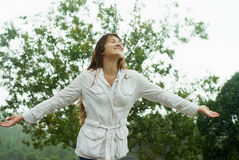 Beautiful girl stands in the rain Stock Photos