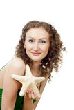 Beautiful girl with the starfish Stock Images