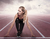 Beautiful girl in starting position. On the track Royalty Free Stock Photography