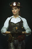 Beautiful girl steampunk. Posing with the clock. PortraBeautiful girl steampunk. Posing with the small clock Stock Photo