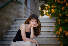 Beautiful girl on the steps Royalty Free Stock Photo