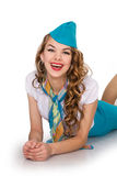 Beautiful girl the stewardess lying smiles Stock Photo