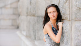 Beautiful girl about stone wall Royalty Free Stock Images