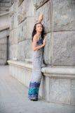 Beautiful girl about stone wall Royalty Free Stock Image