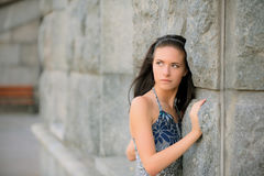 Beautiful girl about stone wall Royalty Free Stock Photography