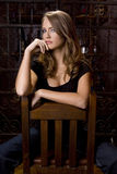 Beautiful Girl Straddling Chair Royalty Free Stock Photography