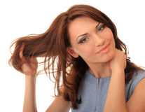 Beautiful girl straightens her hair Stock Image