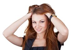 Beautiful girl straightens her hair Royalty Free Stock Photography