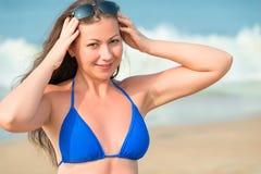 Beautiful girl straightens sunglasses Stock Photos