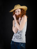 Beautiful girl in a straw hat Royalty Free Stock Images