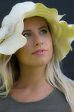 Beautiful girl with straw hat. Blonde girl with white straw hat looking with rapt up Stock Photos