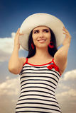 Beautiful Girl with Straw Hat on Blue Sky Stock Photo