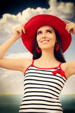 Beautiful Girl with Straw Hat on Blue Sky Royalty Free Stock Photo
