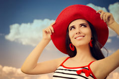 Beautiful Girl with Straw Hat on Blue Sky Royalty Free Stock Photography
