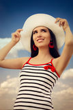Beautiful Girl with Straw Hat on Blue Sky Royalty Free Stock Photos