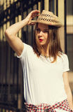Beautiful girl in a straw hat Royalty Free Stock Photography