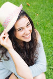 Beautiful girl with straw hat laughing Stock Photos