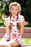 Beautiful girl with a strawberry Stock Photos