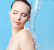 Beautiful girl and stream of water Royalty Free Stock Photo