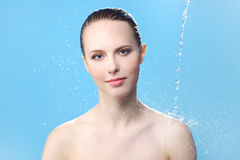 Beautiful girl and stream of water Royalty Free Stock Images