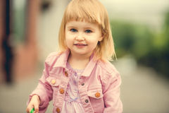 Beautiful girl in the street close up Royalty Free Stock Image