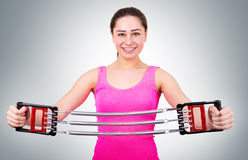 Beautiful girl stretches expander Royalty Free Stock Photo
