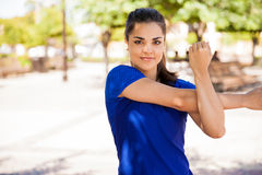 Beautiful girl stretching her arms Royalty Free Stock Photography