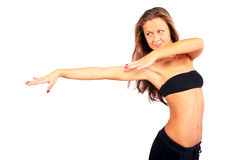 Beautiful girl strikes graceful pose Stock Images