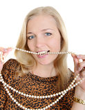 Beautiful girl   a string of pearls between her teeth Royalty Free Stock Photography
