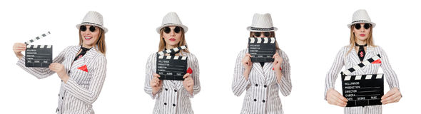 Beautiful girl in striped clothing holding clapperboard isolated Stock Photo