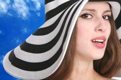 Beautiful girl in striped hat Royalty Free Stock Images