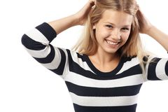 Beautiful girl in a striped sweater cute smiling Royalty Free Stock Photos