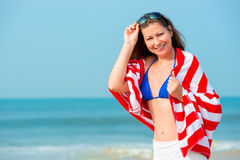 Beautiful girl with striped towel Royalty Free Stock Photos