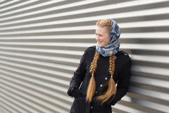 Beautiful girl on a striped wall background Stock Photo